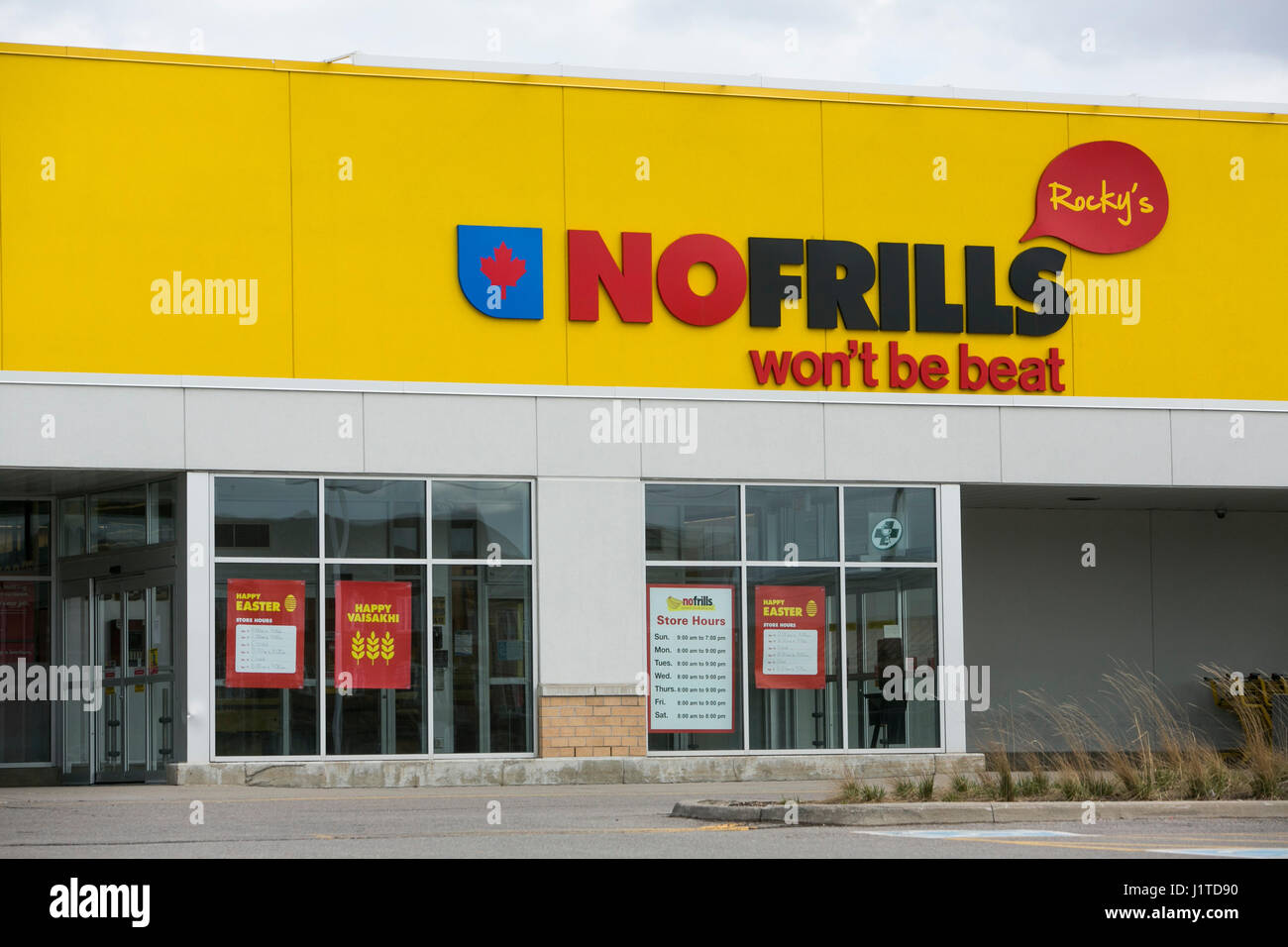 A Logo Sign Outside Of No Frills Grocery Retail Store In Mississauga Ontario