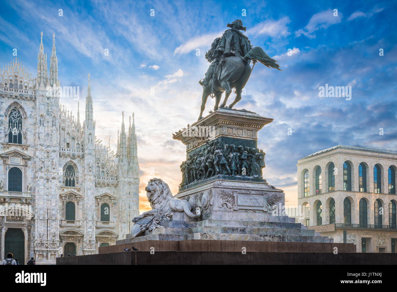 Piazza del Duomo, Milan, Italy. Equestrian monument to king Vittorio Emanuele II at dawn. In the background the - Stock Image