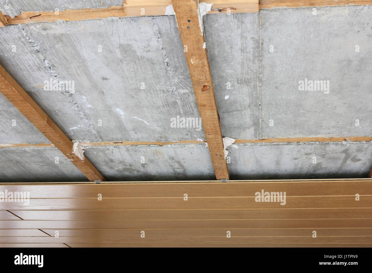 assembling / disassembling of ceiling panels - Stock Image