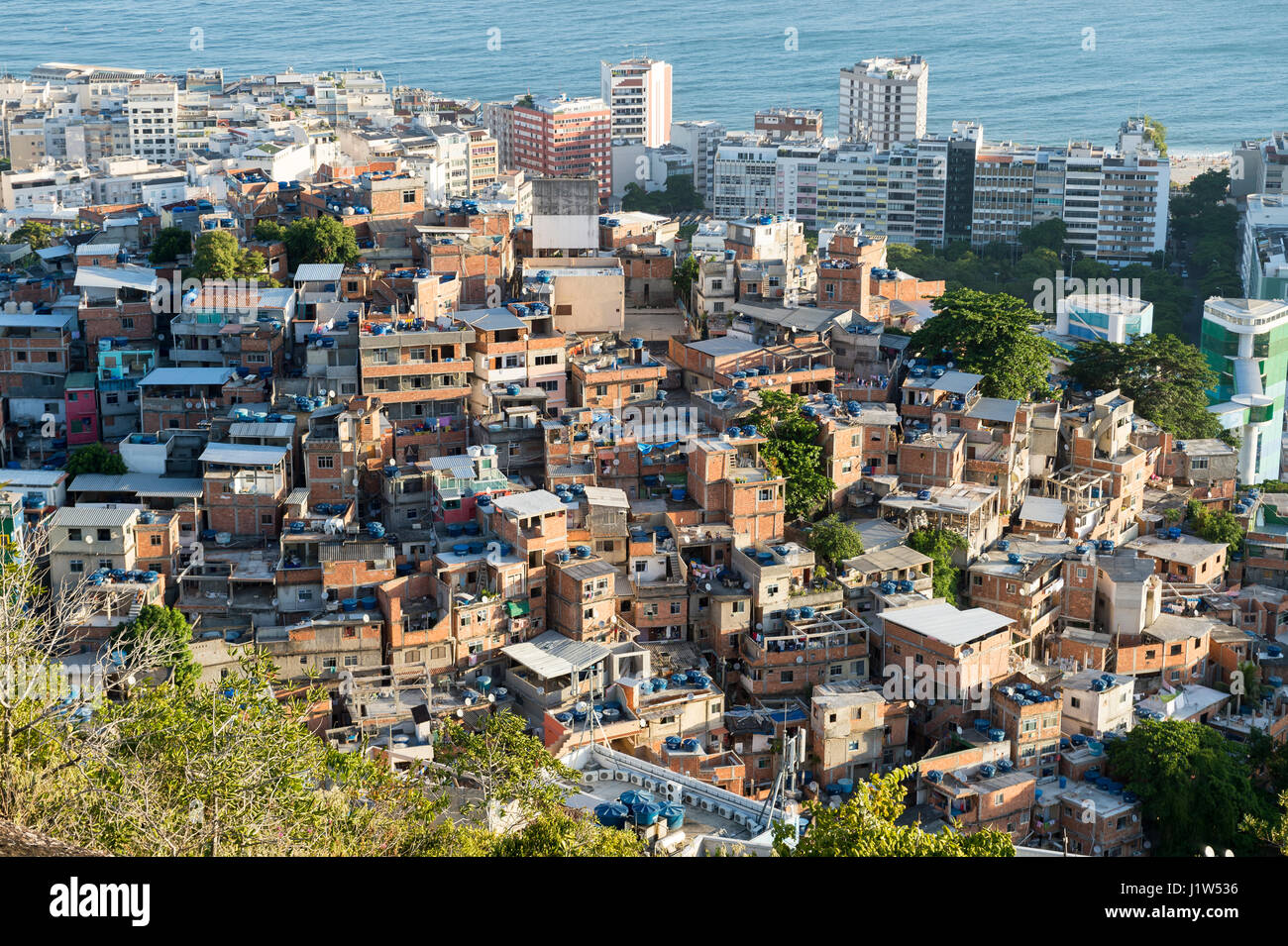 Scenic view over the hillside favela community of Cantagalo overlooking the neighborhood of Ipanema in Rio de Janeiro, - Stock Image