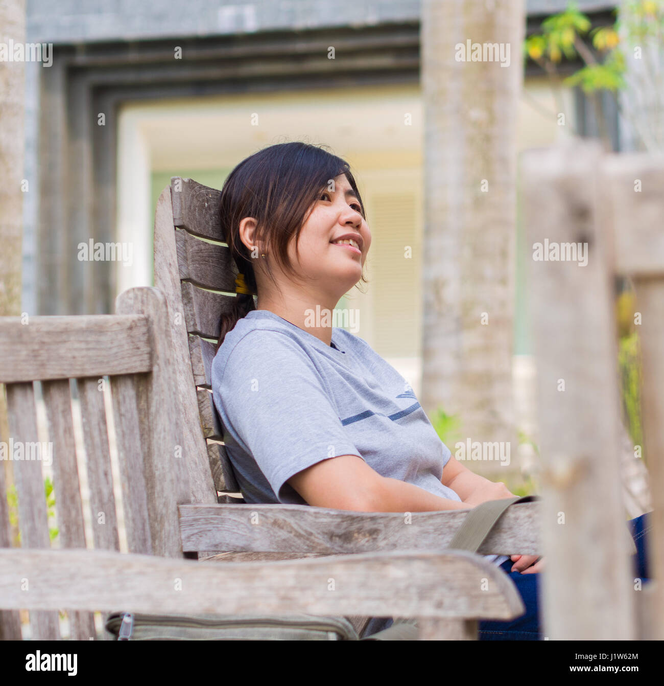 Chinese woman in park - Stock Image