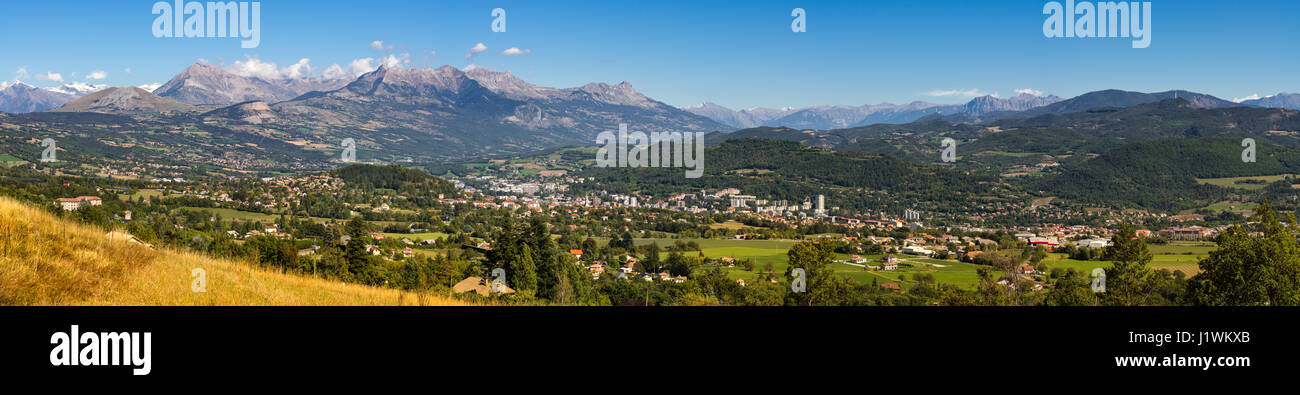 Panoramic summer view of the city of Gap in the Hautes Alpes with surrounding mountains and peaks. Southern French - Stock Image