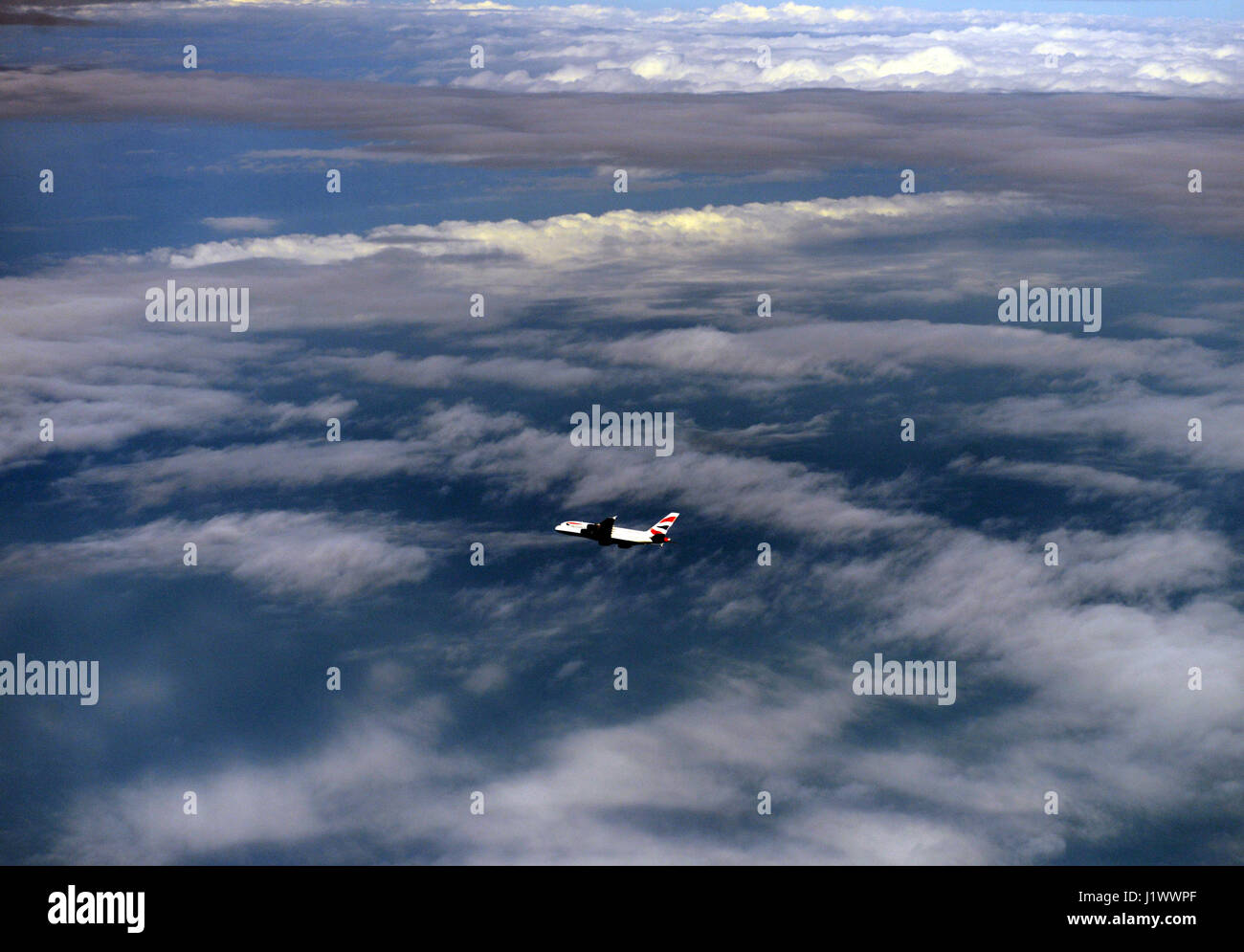 British airways Airbus A380 flying high above the clouds. - Stock Image