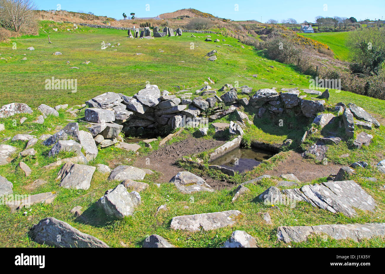 Fulacht fiadh water trough and fireplace building at Drombeg stone circle, County Cork, Ireland, Irish Republic Stock Photo