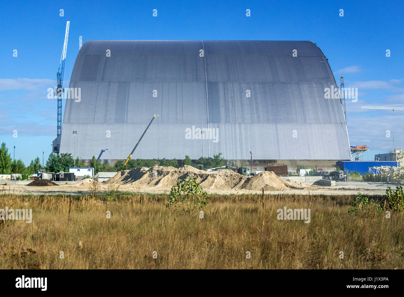 Chernobyl New Safe Confinement for No 4 unit of Chernobyl Nuclear Power Plant in Zone of Alienation, Ukraine - Stock Image