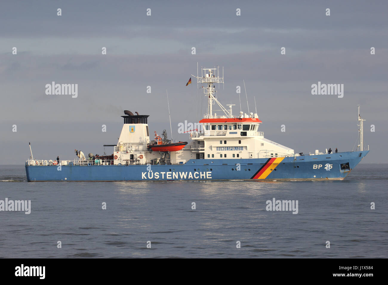 German Federal Police boat BP25 BAYREUTH on the river Elbe. The Kustenwache is an association of several federal - Stock Image