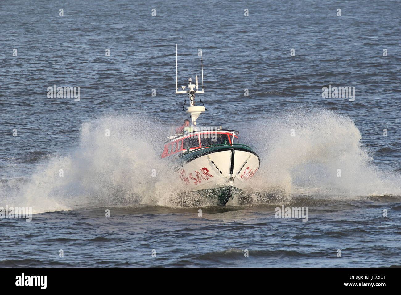 DGzRS SAR lifeboat BIENE on the river Elbe. The DGzRS is responsible for Search and Rescue in German territorial - Stock Image