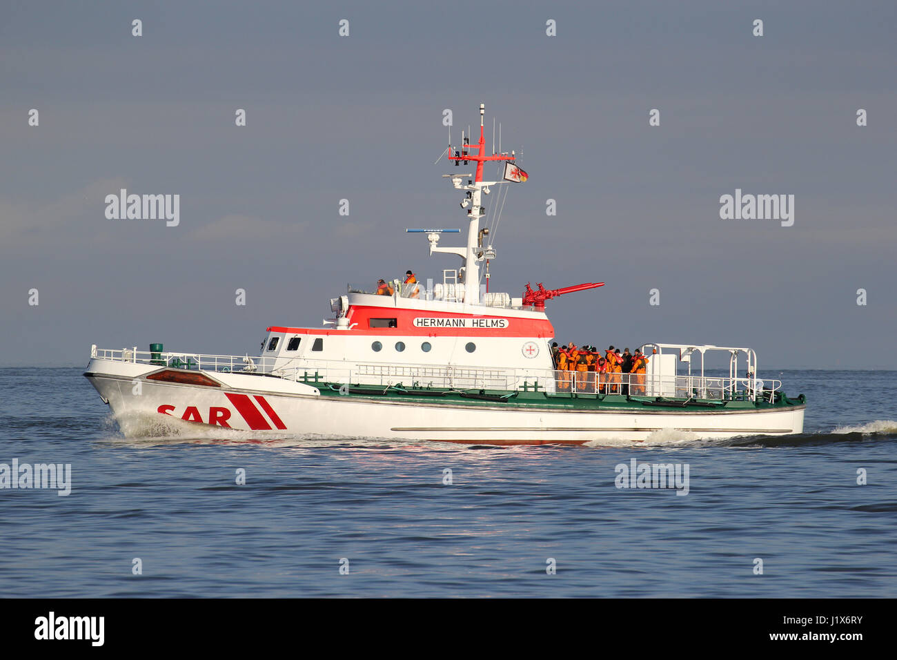 DGzRS SAR cruiser HERMANN HELMS on the river Elbe. The DGzRS is responsible for Search and Rescue in German territorial - Stock Image