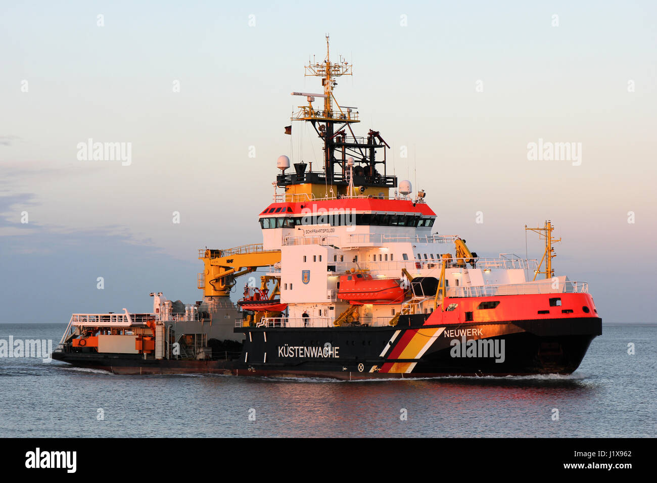 multi-purpose vessel NEUWERK on the river Elbe. The Kustenwache is an association of several federal agencies. - Stock Image