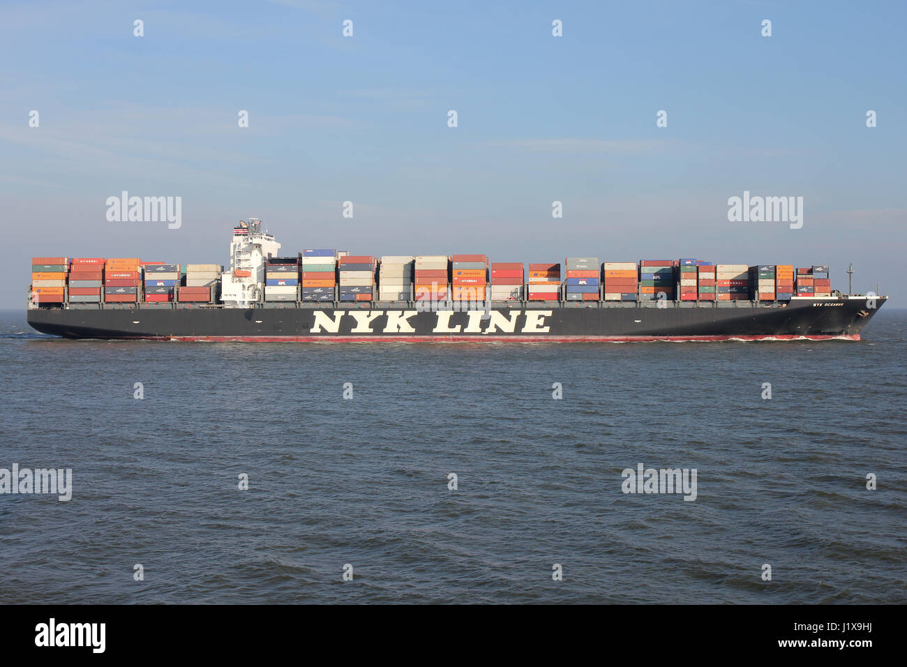 NYK OCEANUS on the river Elbe. Nippon Yusen Kabushiki Kaisha (NYK) is one of the oldest and largest shipping companies - Stock Image