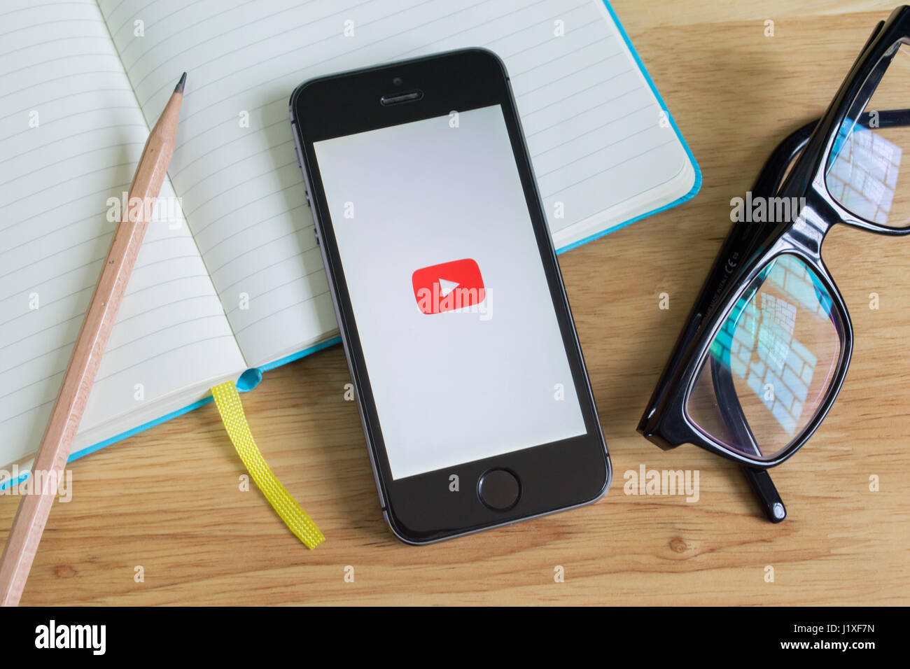 Bangkok, Thailand - April 22, 2017 : Apple iPhone5s showing its screen with YouTube application. Stock Photo