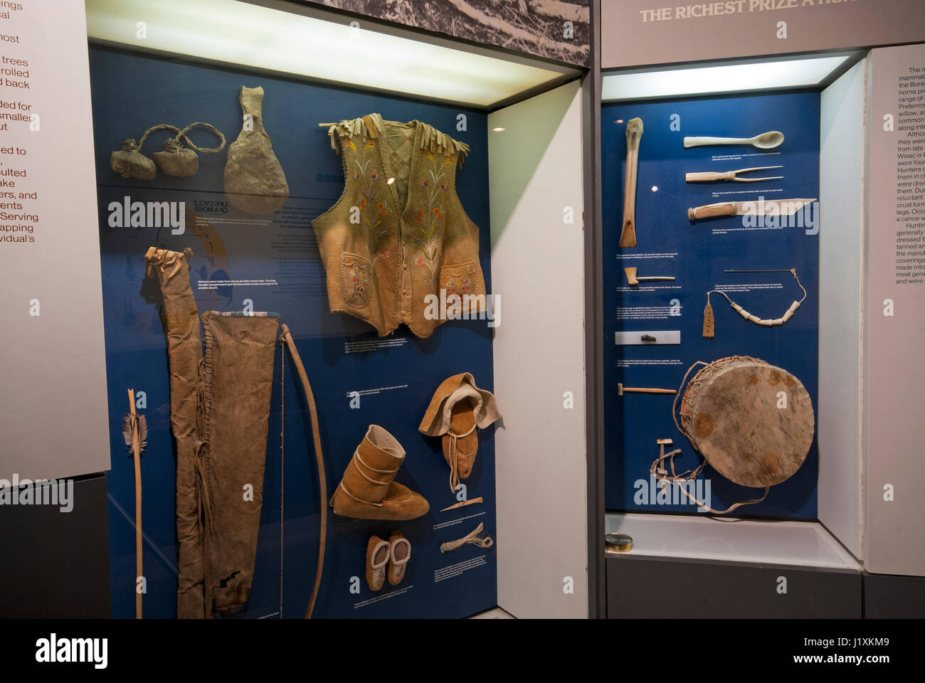 Clothing of Natives (made of moose skin) and objects made of wood and bone, Manitoba Museum, Winnipeg, Manitoba, - Stock Image