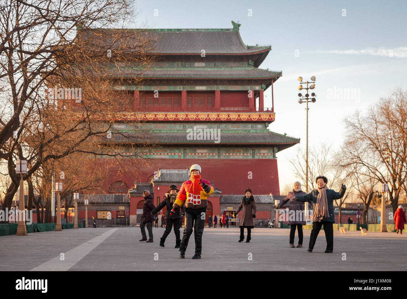 Early morning exercises at the square near the Drum Tower, Beijing, China. The tower is a later Ming dynasty version - Stock Image