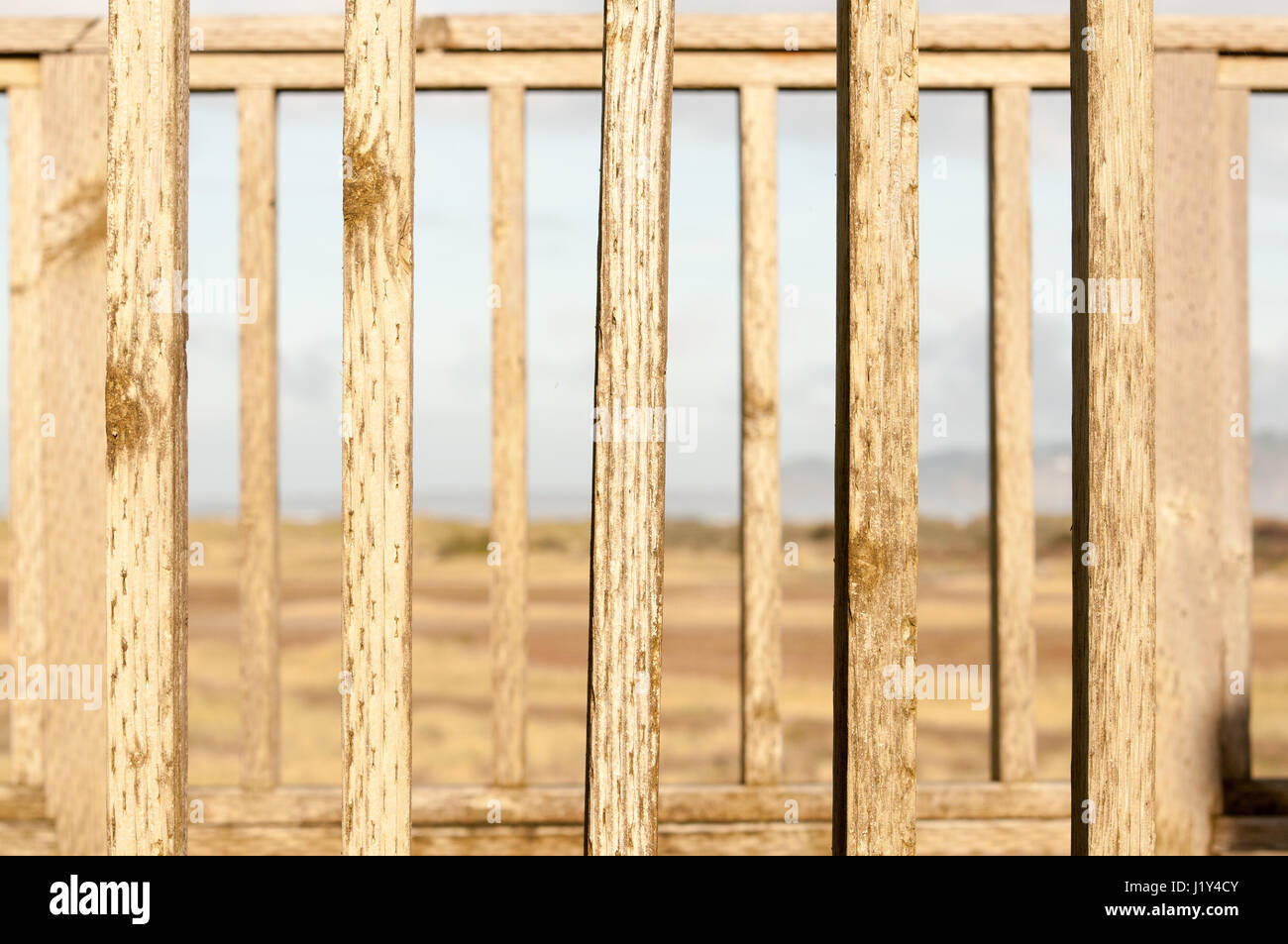 Rural scene, seen through wooden fence, close-up - Stock Image