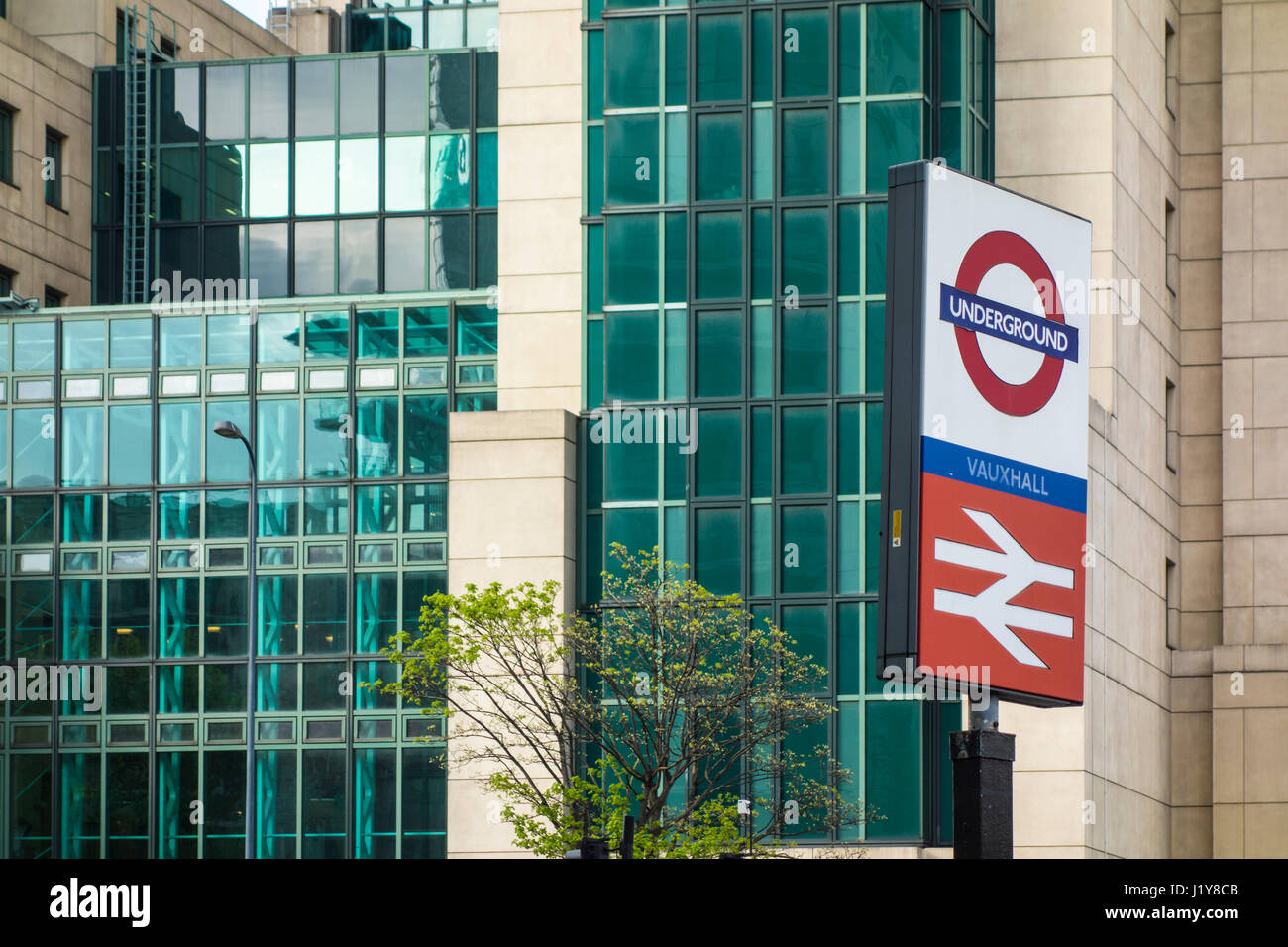 Vauxhall underground station sign in front of MI6 building, London, UK - Stock Image
