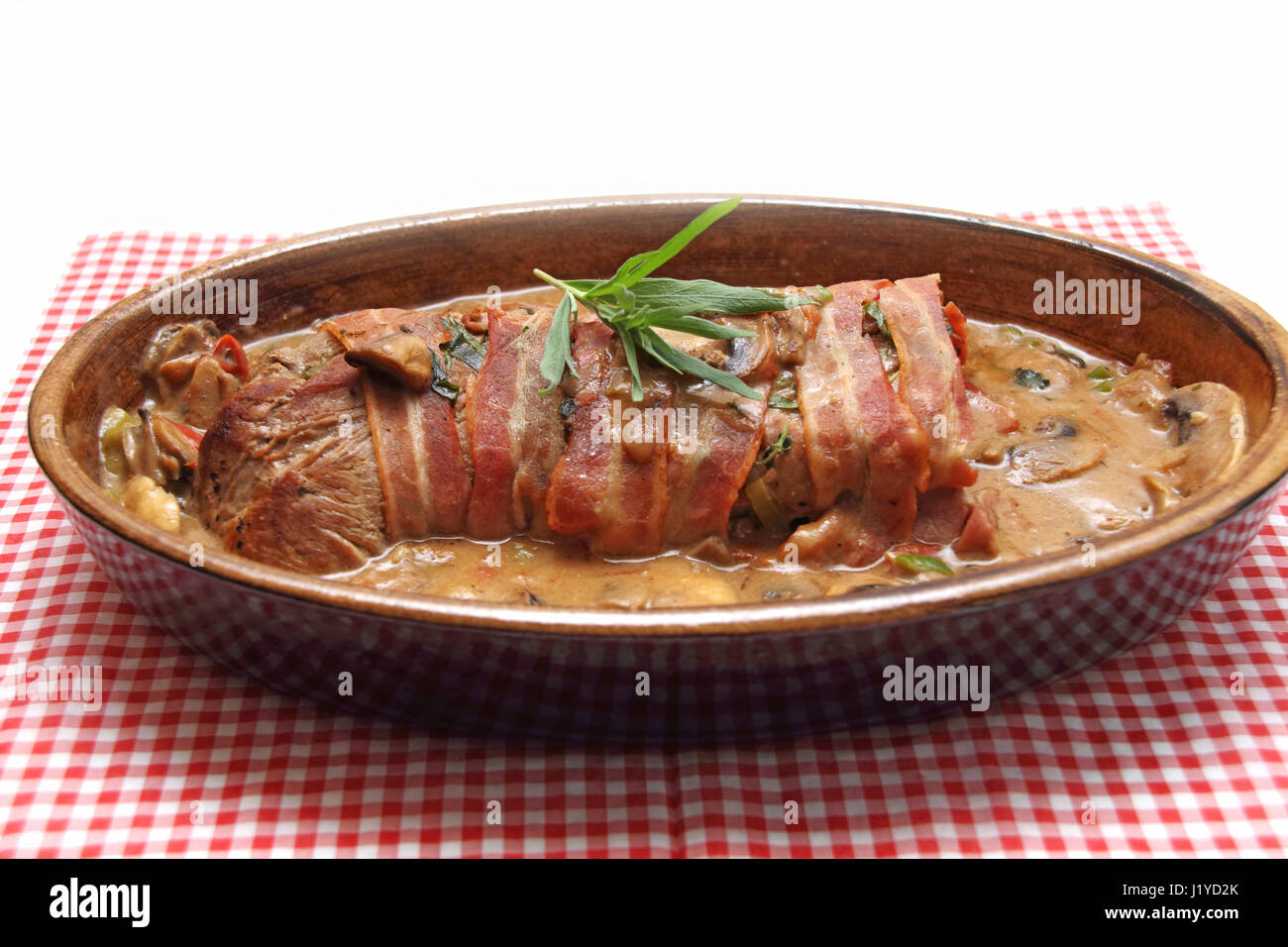 Schweinefilet im Speckmantel Stock Photo