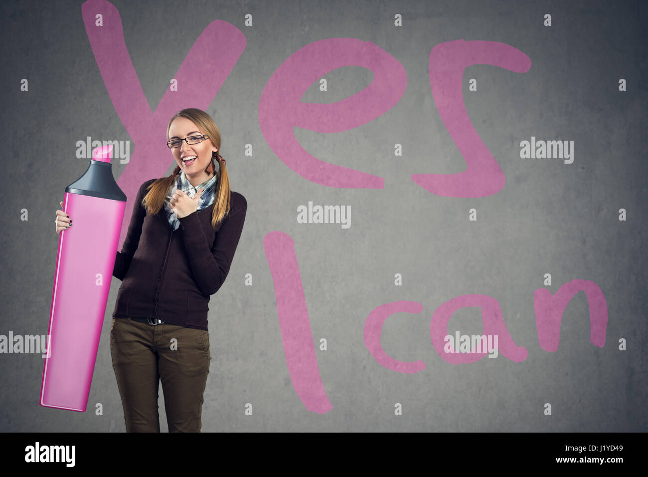 Cute girl believe in yourself with sing yes I can in background - Stock Image