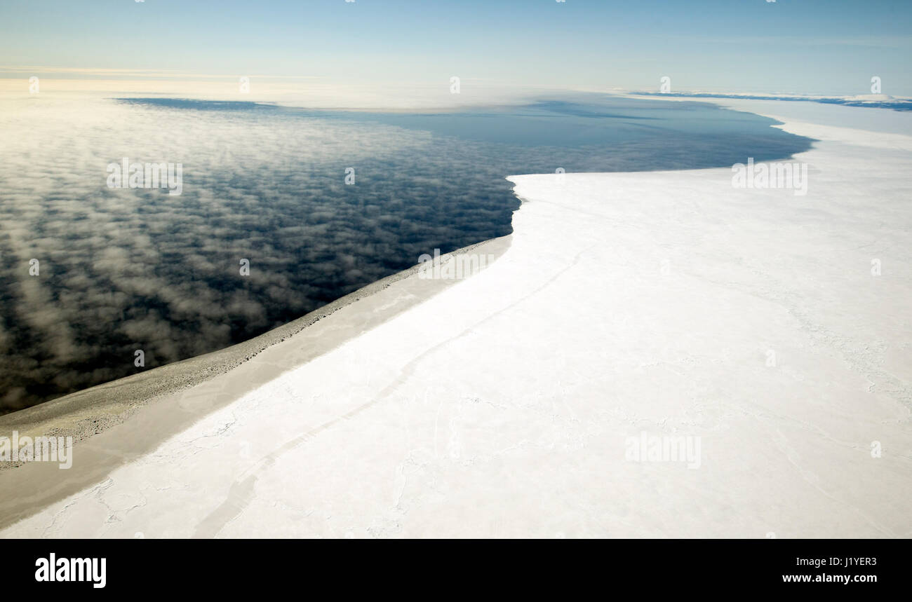 Sea ice on the Norton Sound and fog over open water. The warmer days of spring and the melting sea ice is soon to Stock Photo