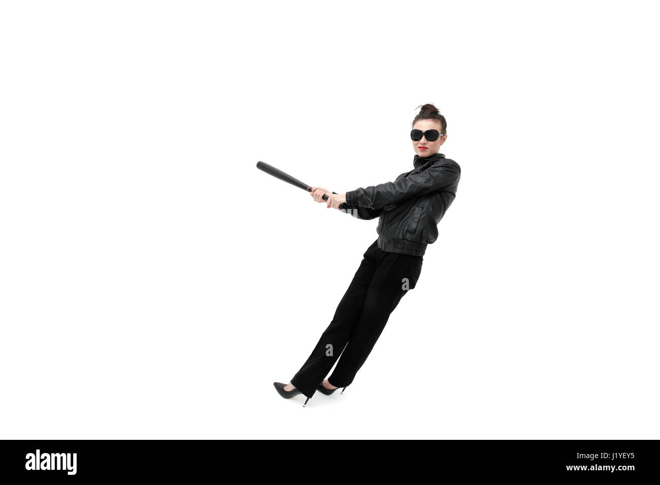 Portrait of an angry woman with a bat, isolated on white background. Serious and strict debt collector - Stock Image