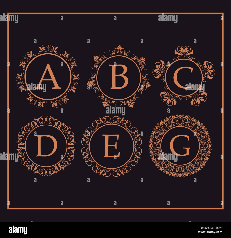 calligraphic monogram golden emblem swirls design - Stock Image