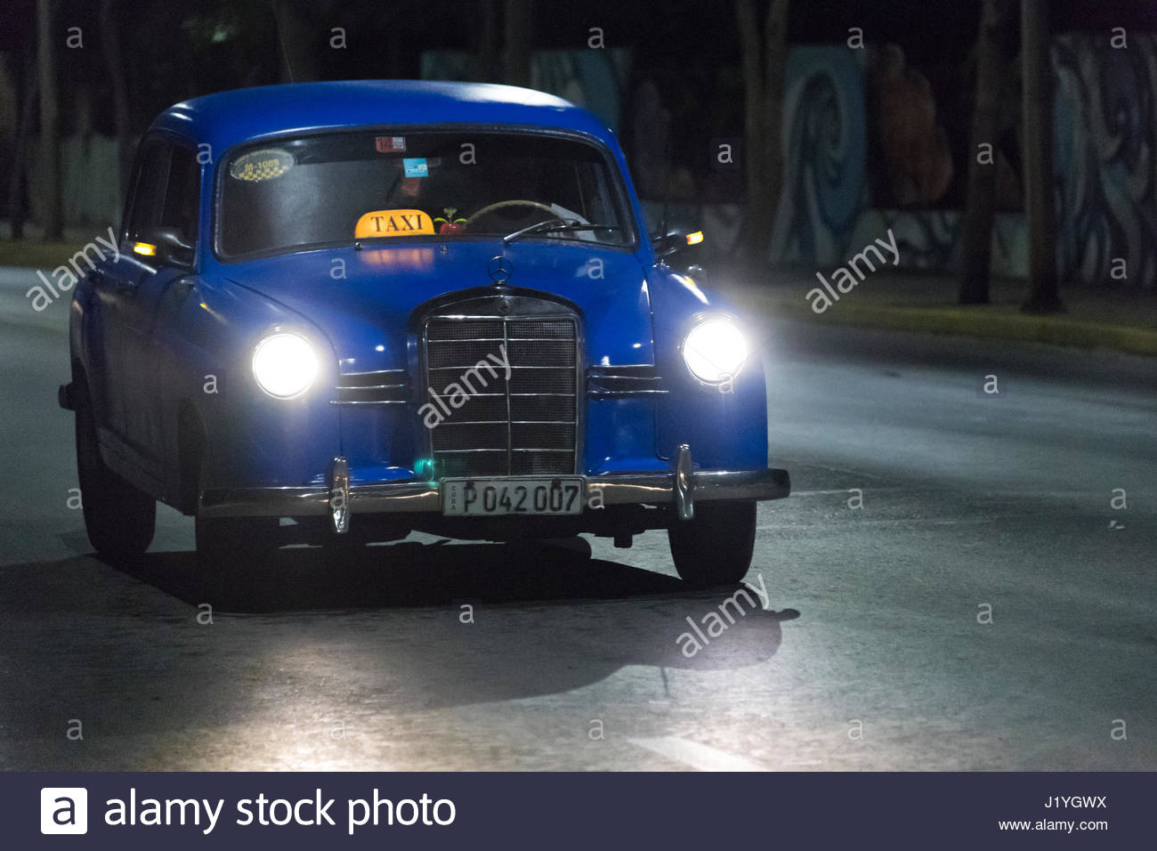 Mercedes Benz, Old obsolete American cars in action during nighttime ...