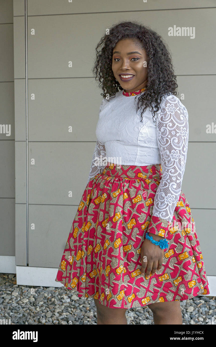 A beautiful young lady from Ghana wearing traditional Ghanaian clothing on Easter Sunday. In Springfield, Massachussets. - Stock Image