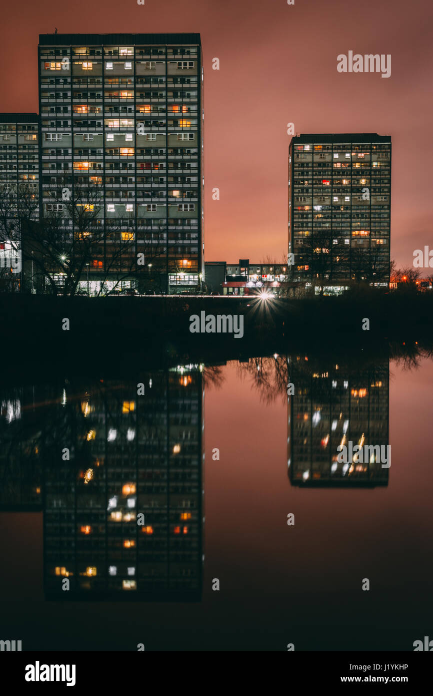 High rise flats in the Gorbals reflected in the river Clyde in Glasgow, Scotland at night. Image taken from Glasgow - Stock Image