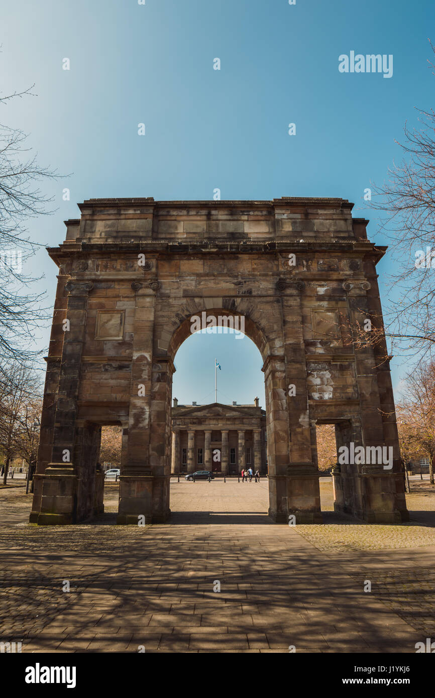 The McLennan Arch at Glasgow Green with a view of the High Court of Justiciary through the archway. - Stock Image