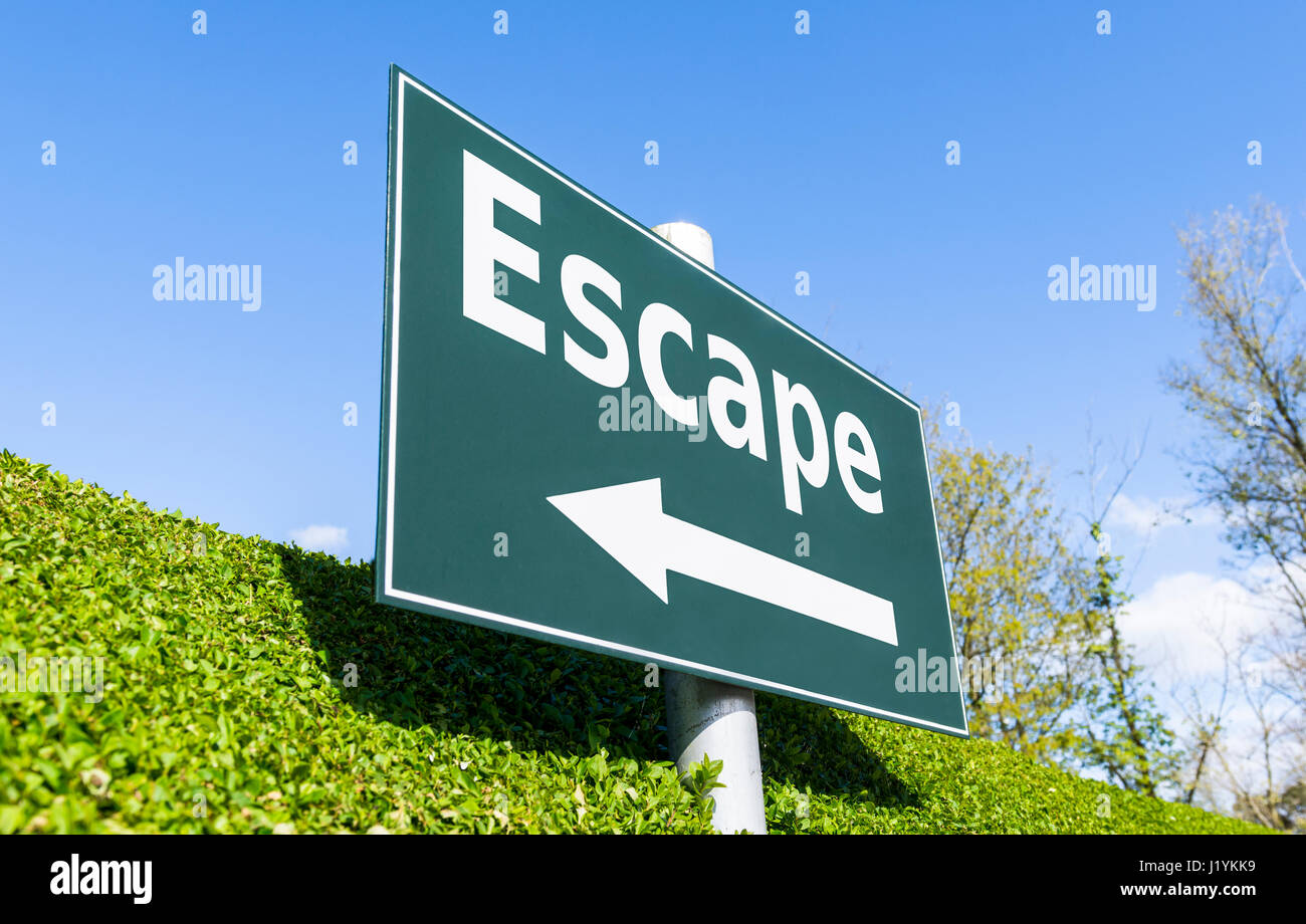 Escape concept sign. Escape and an arrow on a signpost. - Stock Image