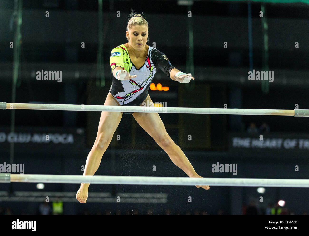 Cluj Napoca, Romania. 22nd Apr, 2017. Elisabeth Seitz from Germany competes at the asymmetrical bars at the UEG Stock Photo