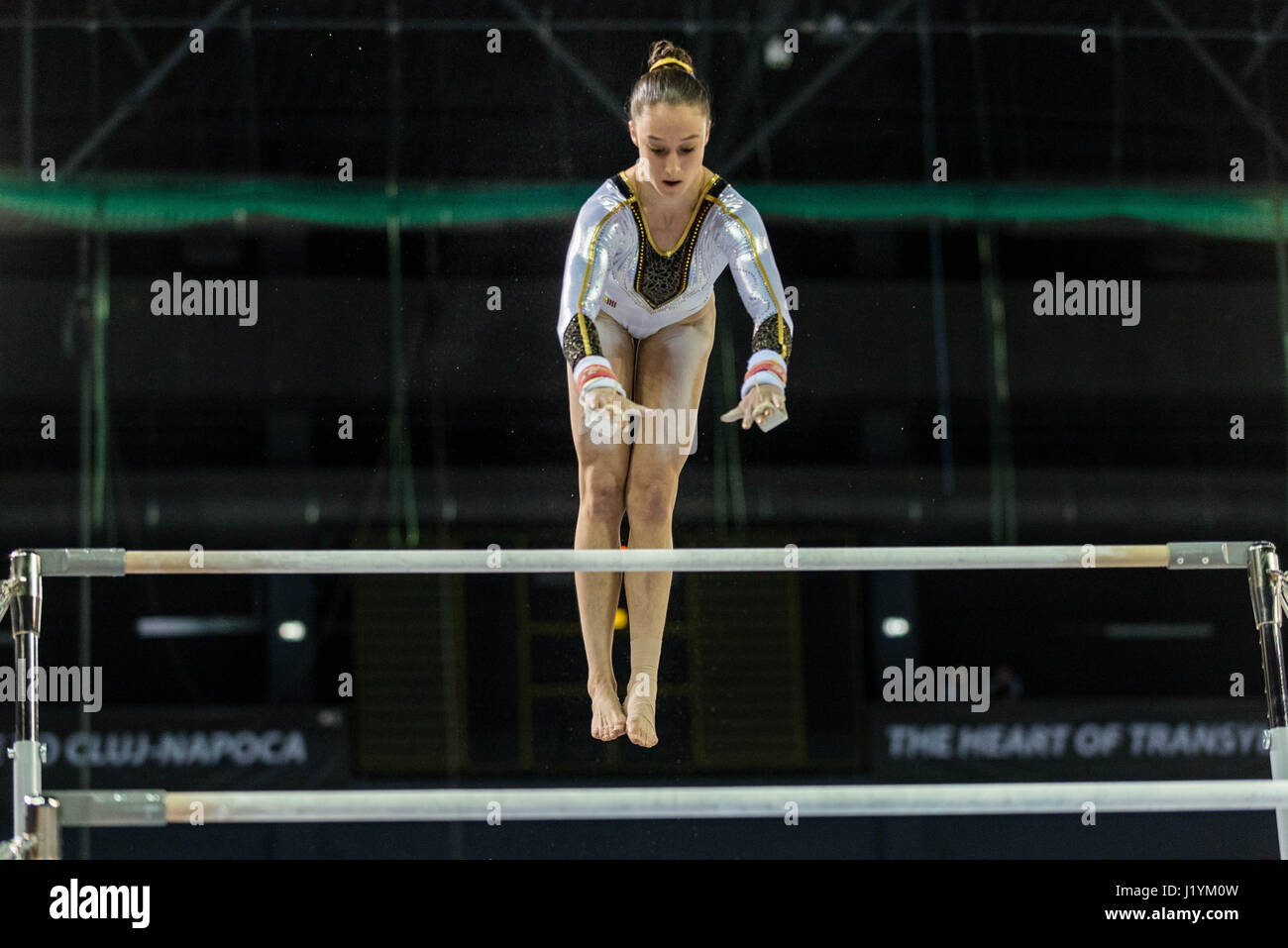 Cluj Napoca, Romania. 22nd Apr, 2017. Nina Derwael from Belgium competes at the asymmetrical bars at the UEG European - Stock Image