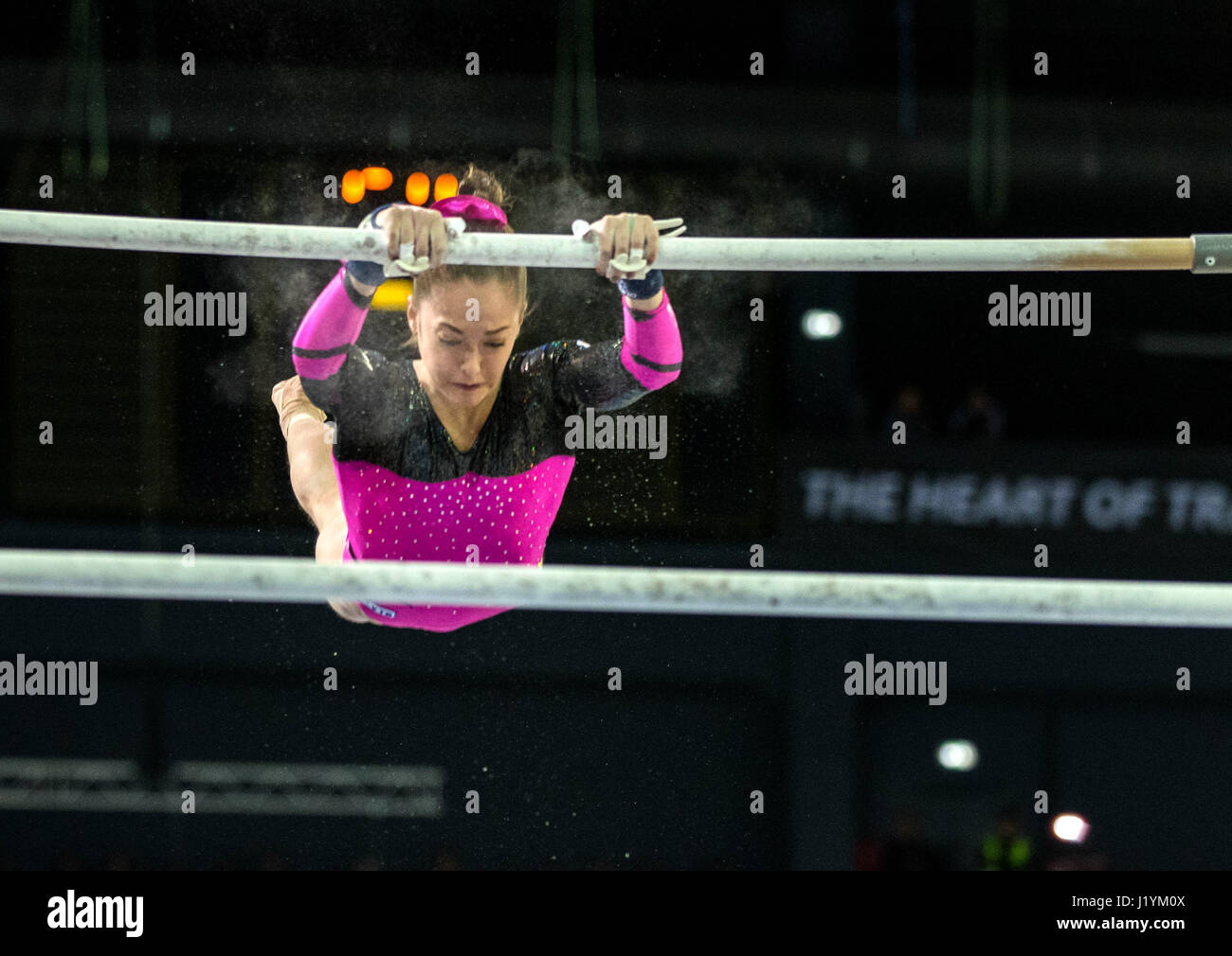 Cluj Napoca, Romania. 22nd Apr, 2017. Jelena Jeremina from Russia competes at the asymmetrical bars at the UEG European Stock Photo