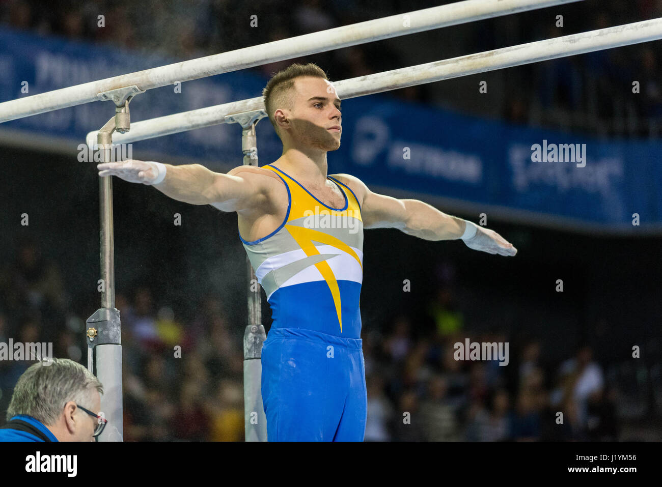 Cluj Napoca, Romania. 21st Apr, 2017. Oleg Vernjajev from Ukraine performs at the bar at the UEG European Championships - Stock Image