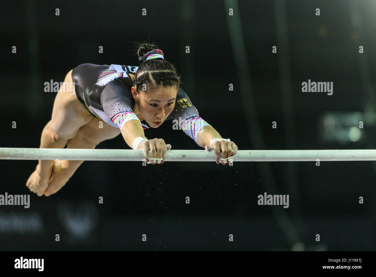 Cluj Napoca, Romania. 22nd Apr, 2017. Kim Bui from Germany competes at the asymmetrical bars at the UEG European Stock Photo