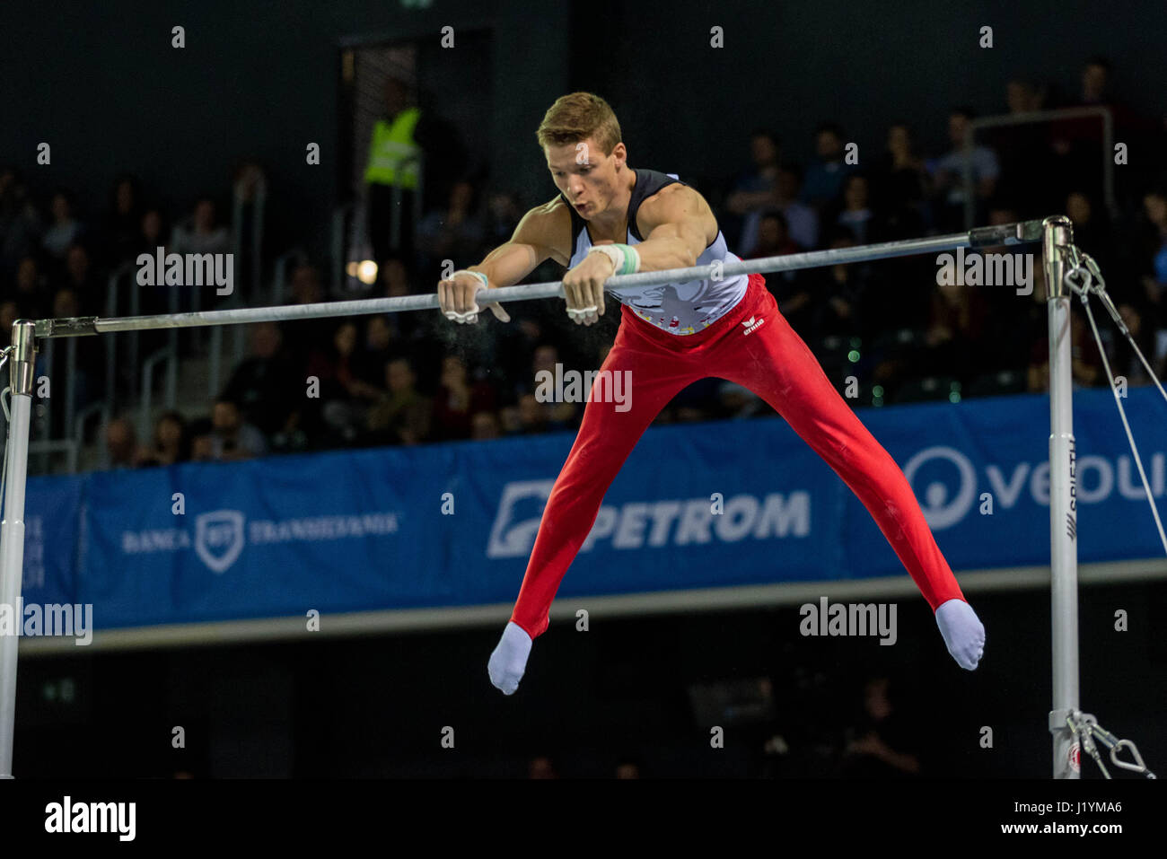 Cluj Napoca, Romania. 21st Apr, 2017. Philipp Herder from Germany performs at the bar at the UEG European Championships - Stock Image