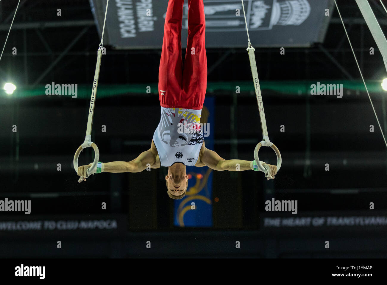 Cluj Napoca, Romania. 21st Apr, 2017. Philipp Herder from Germany performs at the rings at the UEG European Championships Stock Photo