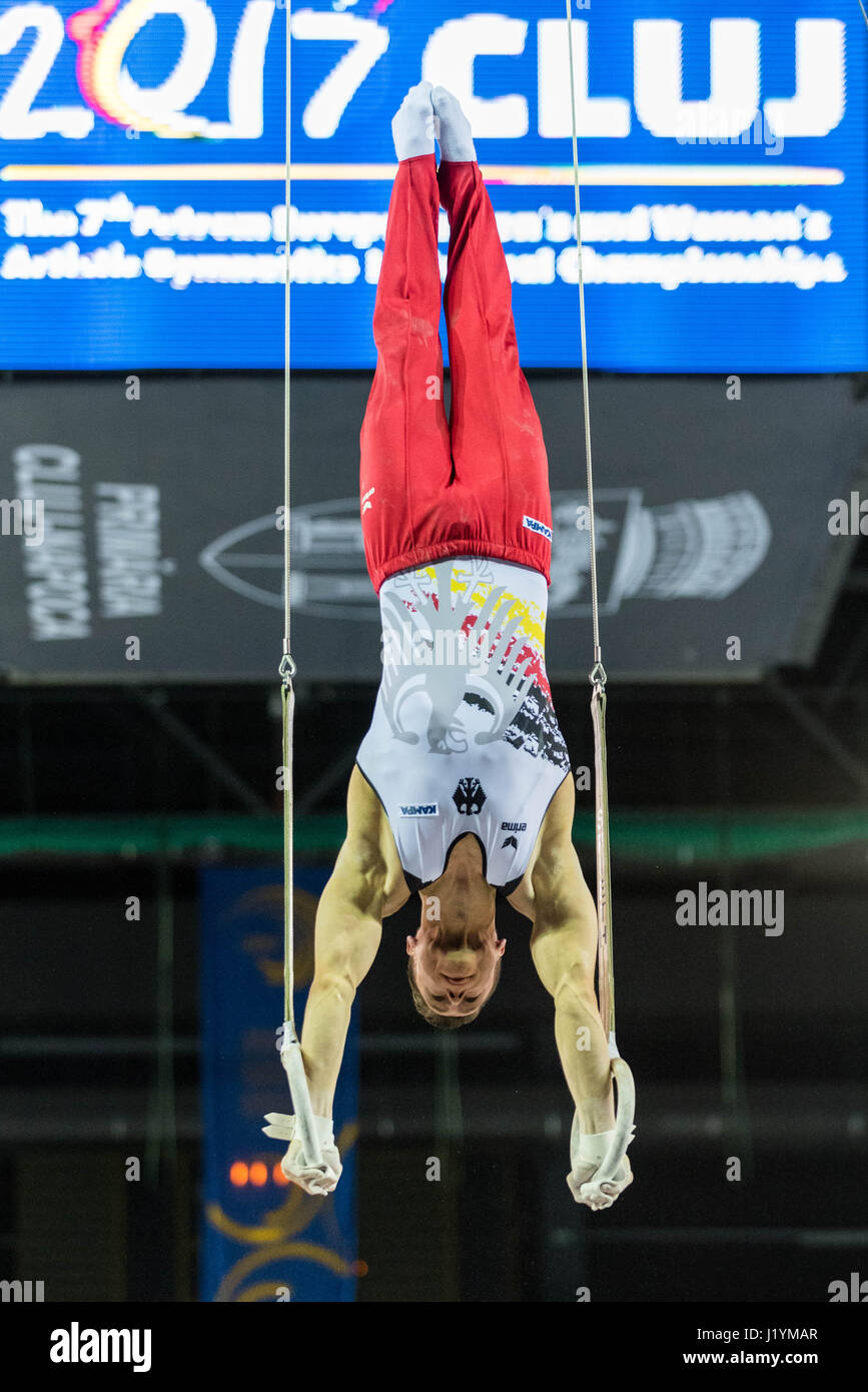 Cluj Napoca, Romania. 21st Apr, 2017. Lukas Dauser from Germany performs at the rings at the UEG European Championships - Stock Image