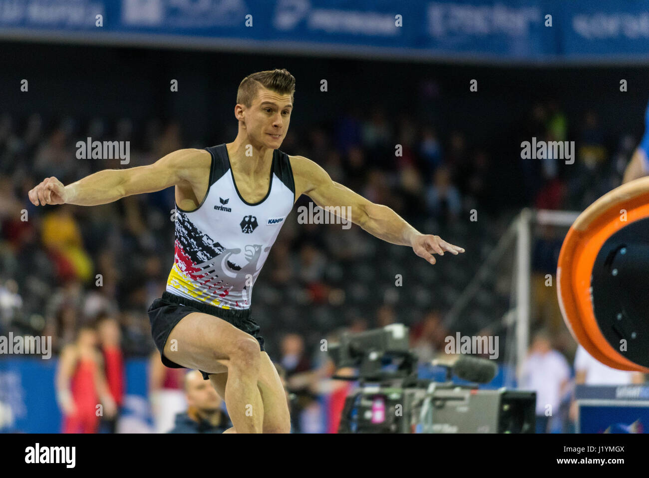 Cluj Napoca, Romania. 21st Apr, 2017. Lukas Dauser from Germany performs at the vault at the UEG European Championships Stock Photo