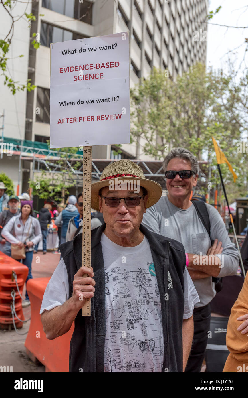 San Francisco, California, USA. 22nd April, 2017. At the San Francisco March for Science, a man holds a humorous Stock Photo