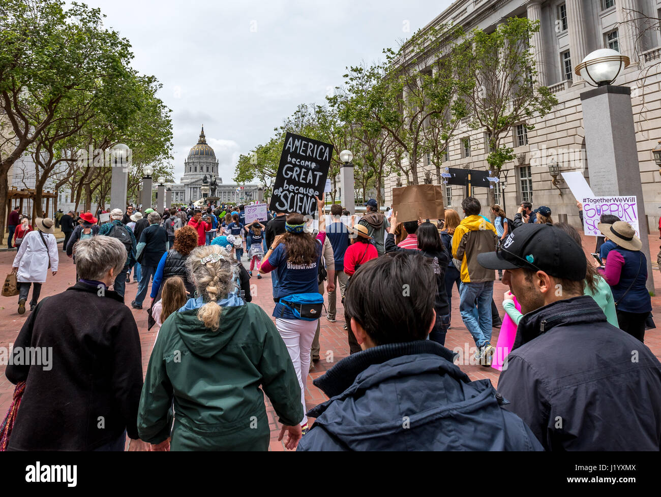 San Francisco, California, USA. 22nd April, 2017. Earth Day marchers approach San Francisco City Hall and the Civic Stock Photo