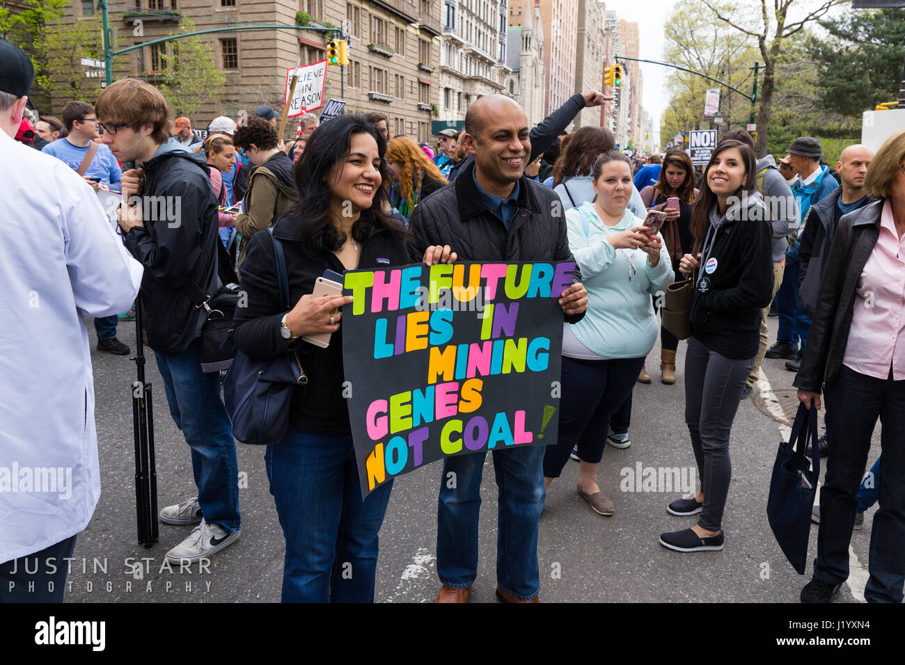 "New York, USA. 22nd April, 2017. An unidentified man and woman hold a sign that reads ""The Future Lies In Mining Stock Photo"