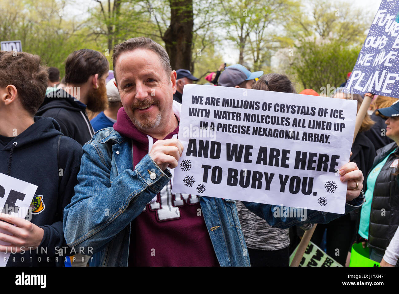 New York, USA. 22nd April, 2017. An unidentified man holds a humorous sign that references the derisive use of the Stock Photo