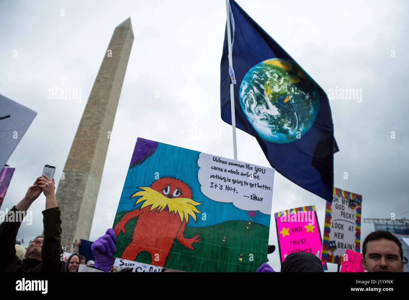 Washington, DC, USA. 22nd April, 2017. Demonstrators gather in Washington DC on Earth Day to participate in the Stock Photo