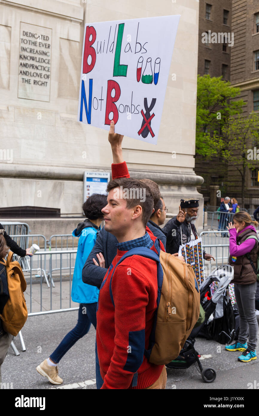 "New York, USA. 22nd April, 2017. An unidentified man holds a sign that reads ""Build Labs Not Bombs"" during the March Stock Photo"