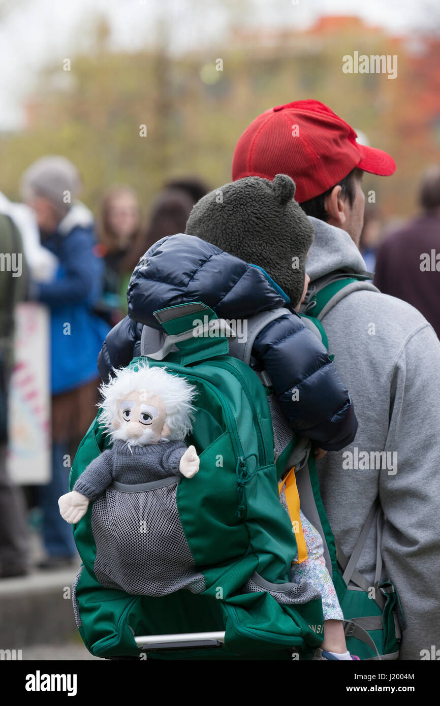 Seattle, Washington,USA. 22nd April, 2017. Family with an Albert Einstein doll at the rally in Cal Anderson Park. Stock Photo