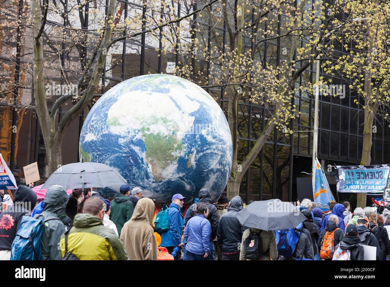 Seattle, Washington,USA. 22nd April, 2017. A large globe makes its way along 4th Avenue on its way to Seattle Center. Stock Photo