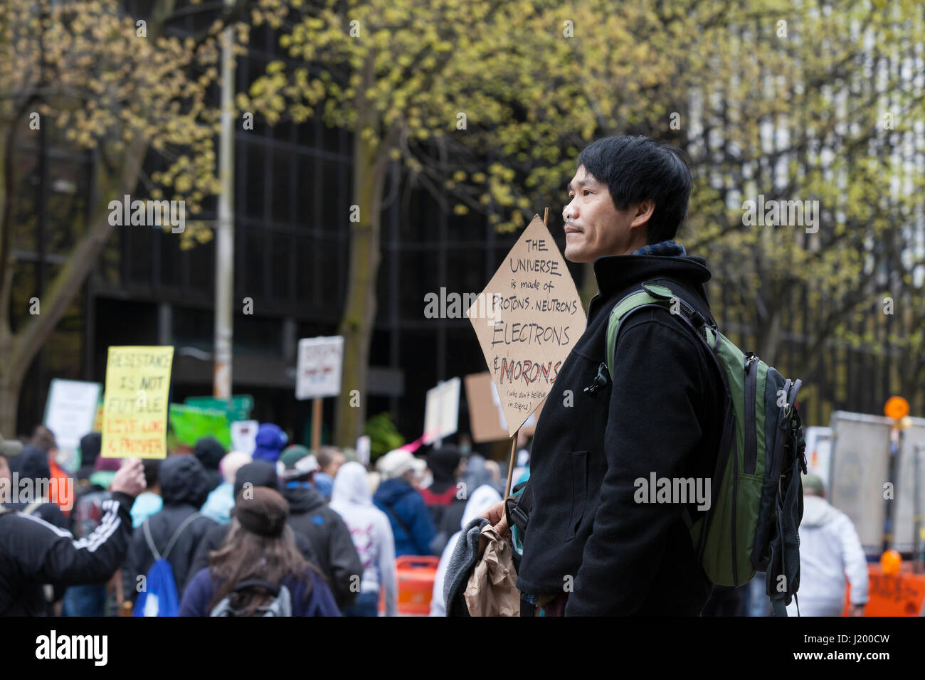 Seattle, Washington,USA. 22nd April, 2017. Bingram L. holds a protest sign at Seattle Cinerama. The March for Science Stock Photo