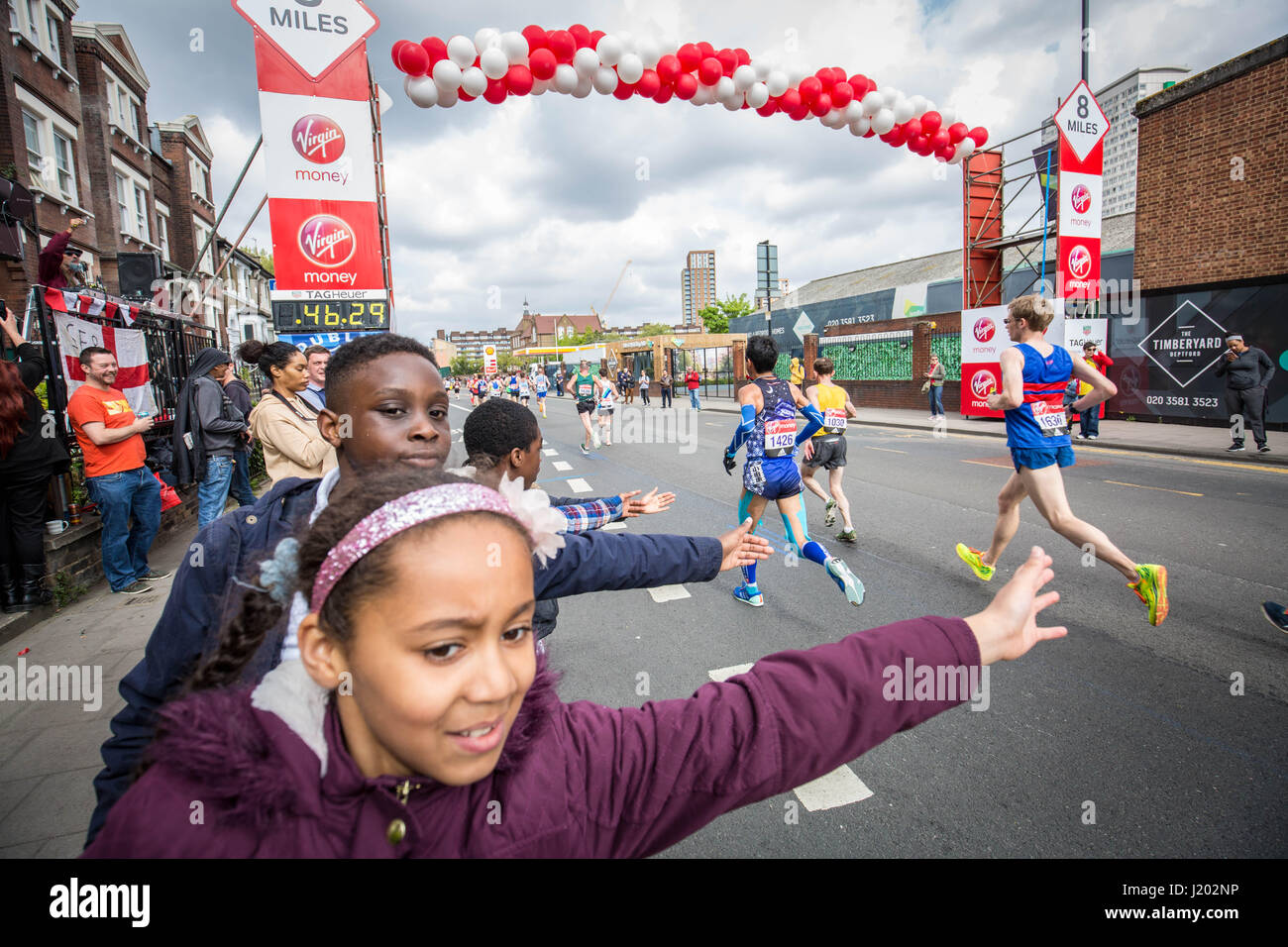 London, UK. 23rd Apr, 2017. Thousands of runners during the 37th London Marathon pass through Deptford in south Stock Photo