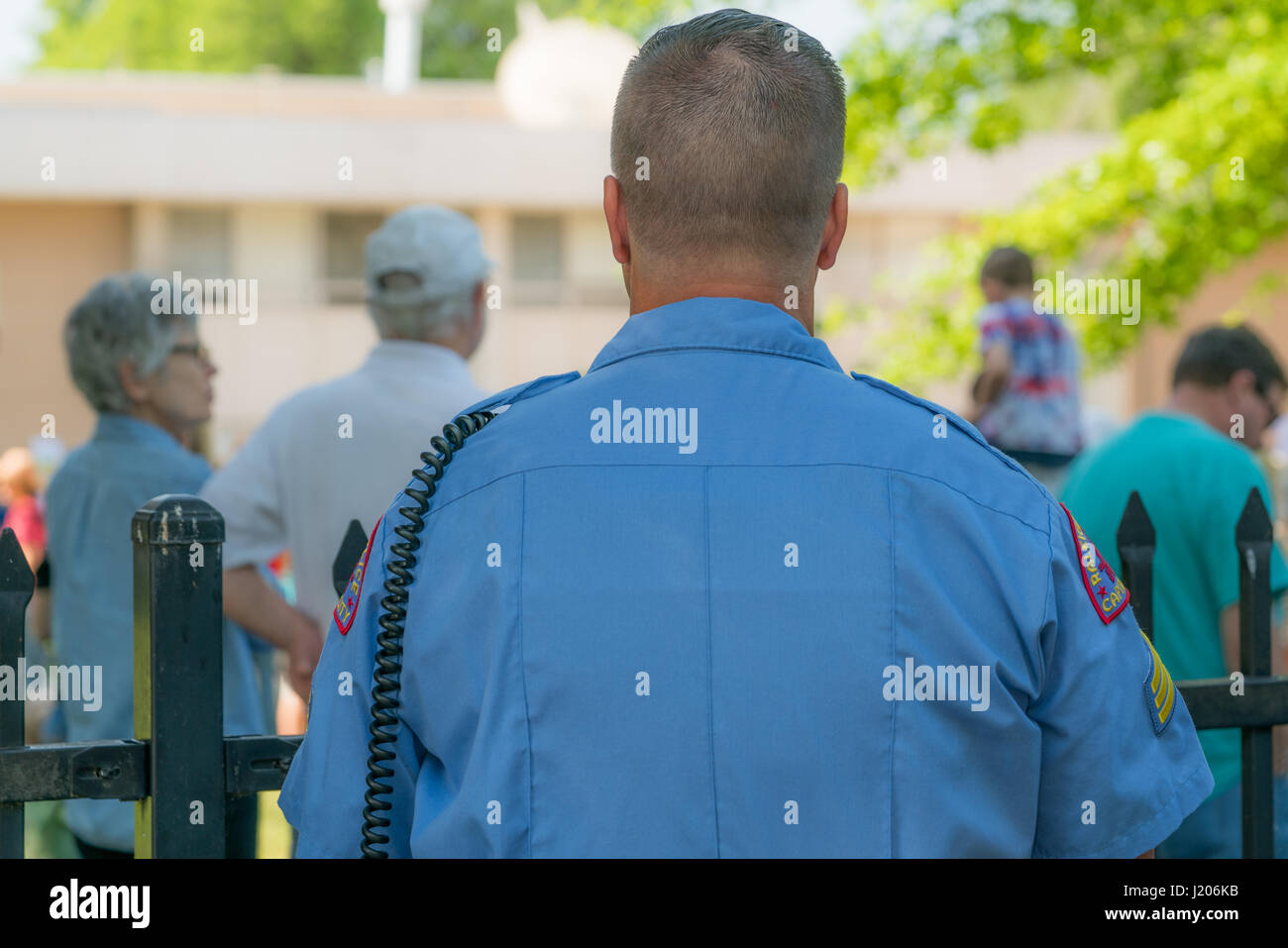 A cop stands ready to keep order at the Raleigh March for Science on April 22, 2017 Stock Photo