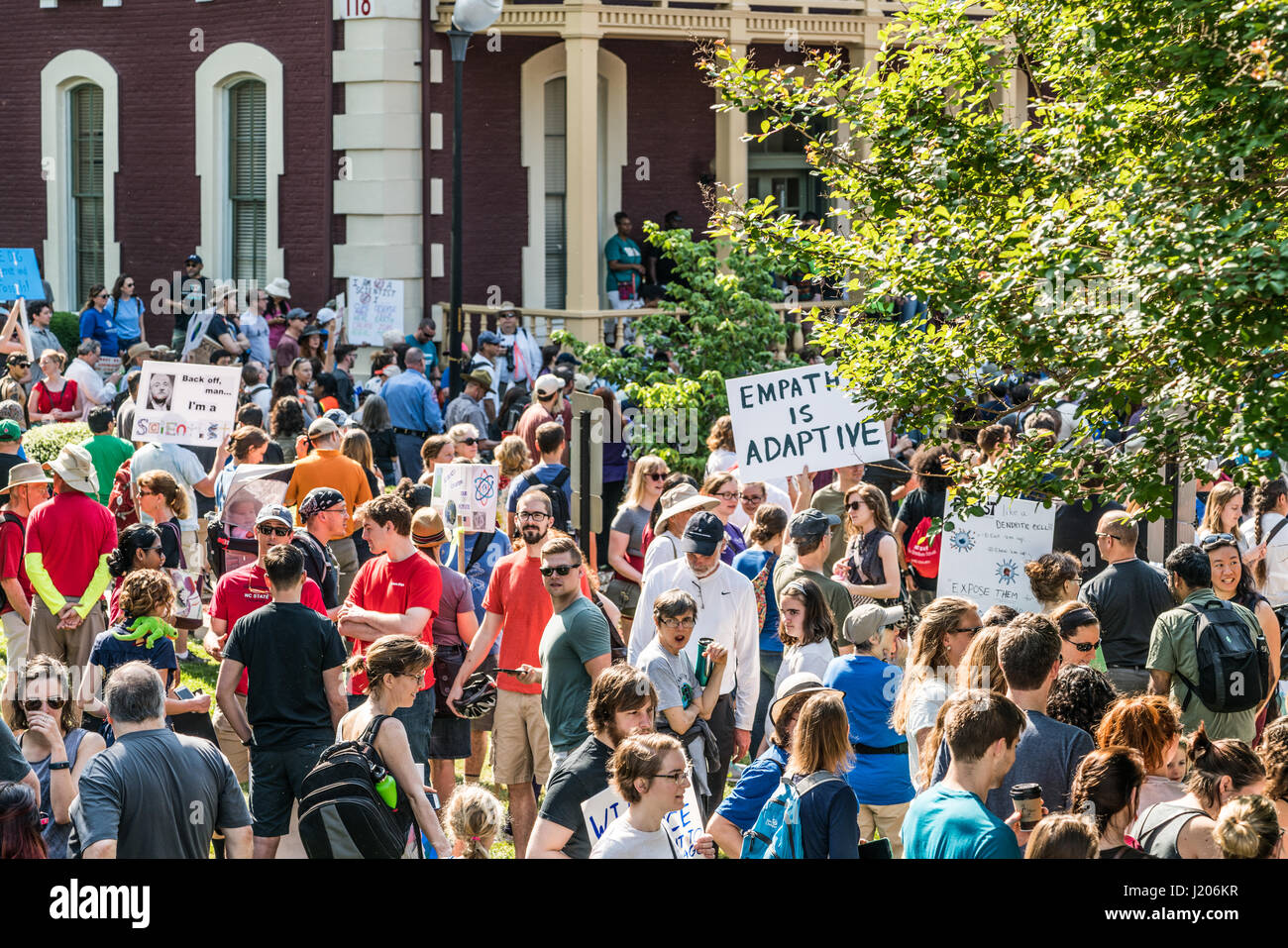 Protesters hold signs high at the Raleigh March for Science held on April 22, 2017. The march kicked off here at Stock Photo